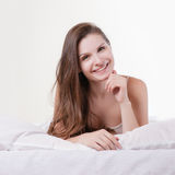 Beautiful romantic woman / girl brunette lying on Royalty Free Stock Photos