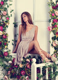 Beautiful romantic woman with long hair sitting and posing on th Royalty Free Stock Photo