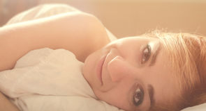 Beautiful romantic woman in morning bed Stock Photos