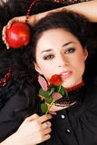 Beautiful romantic woman with a red apple and rose Royalty Free Stock Images
