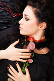Beautiful romantic woman with a red rose Royalty Free Stock Images