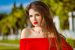 Beautiful Romantic young woman wearing in red over nature park Royalty Free Stock Photography