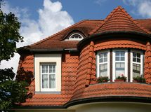 Beautiful roof of a city house. With red roofing tiles Stock Photo