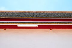 A beautiful roof with a fluorescent light tube. And blue sky stock images