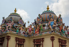 The beautiful roof of the hinduistic temple in Singapore. Beautiful roof of the temple with lots of god figures Stock Images