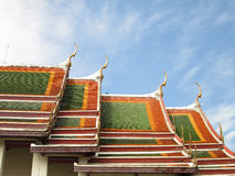 The Beautiful roof of temple on blue sky background Royalty Free Stock Photo