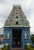 Beautiful roof of the temple with lots of god figures. Hinduistic temple entrance in Singapore Stock Images
