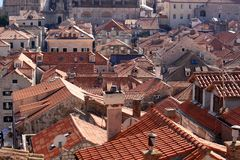 The beautiful roof tops of Dunbrovnik in Croatia. The beautiful walled city of Dubrovnik taken from above, with an elevated view of it`s pretty town and houses royalty free stock images
