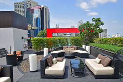 Beautiful Rooftop Settings for Relaxation and Recreational Activities. This is typical hotel settings in Bangkok with fancy bar seating and funky swimming pool stock photo
