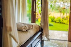 Beautiful room in villa, towel on the bed royalty free stock photo