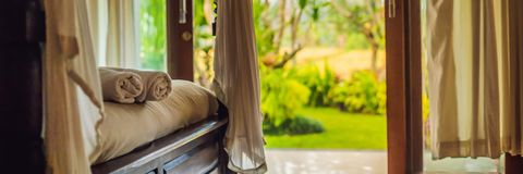 Beautiful room in villa, towel on the bed BANNER, LONG FORMAT stock photography