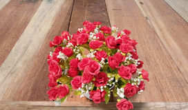 Beautiful rose Artificial flower bouquets on wooden as backgroun Stock Photo