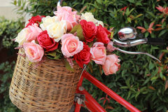 Beautiful of rose artificial flowers in vintage bicycle Stock Photos
