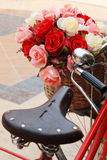 Beautiful of rose artificial flowers in vintage bicycle Stock Photography