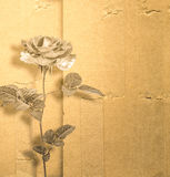 Beautiful rose on background of an old album sheet Stock Photo