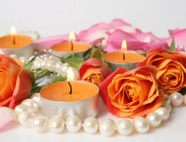 Beautiful rose and Burning candles Royalty Free Stock Images