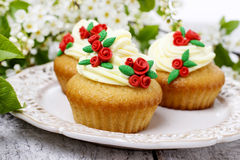 Beautiful rose cupcakes and bird cherries in the background Stock Images