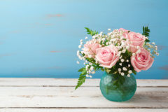 Beautiful rose flowers bouquet on wooden table Stock Image