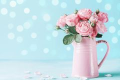 Beautiful rose flowers in pink vase for Womens day or Mothers day greeting card stock images