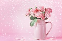 Beautiful rose flowers in pink vase for Womens day or Mothers day greeting card. Beautiful rose flowers in vase for Womens day or Mothers day greeting card stock photos