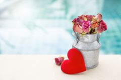 Beautiful rose paper flower in metal pot with red heart Stock Photography