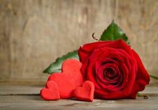 Beautiful rose and three handmade hearts Stock Photos