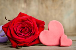 Beautiful rose and two handmade hearts Stock Photos