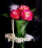 Beautiful rose in vase with beads Stock Photos