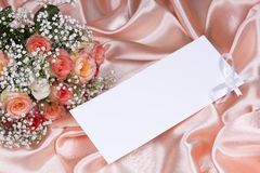 Beautiful roses and card for your text Stock Photo