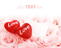 Beautiful roses with gift card & hearts Stock Photography