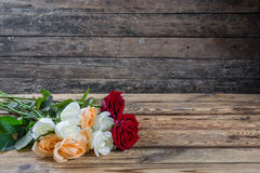 Beautiful roses on table Stock Photos
