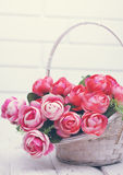 Beautiful  roses, tinted. Beautiful artificial roses in a wicker basket Royalty Free Stock Photos