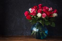 Beautiful roses in vase. On the table. Place for text royalty free stock images