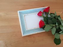 Beautiful Roses With A Vintage Frame. Red roses with a vintage frame laying on a wooden background, Mothers day, Thank you card, Friendship, Love royalty free stock photos