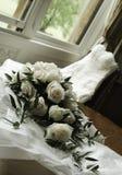 Beautiful roses and wedding dress Stock Photos