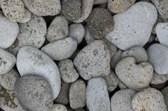 Beautiful round basalt stones on seaside Stock Photos