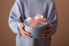 Beautiful round blue gift box with a pink bow royalty free stock images