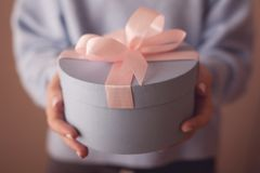 Beautiful round blue gift box with a pink bow stock photos