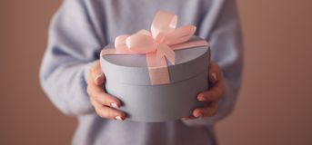 Beautiful round blue gift box with a pink bow stock image