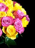 Beautiful round bouquet of pink and uellow roses isolated on black background top view. Beautiful round bouquet of pink and uellow roses flowers on left side of Royalty Free Stock Photography