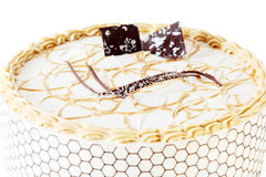 Beautiful round cake with cream and chocolate decorations Royalty Free Stock Images