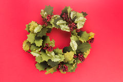 Beautiful round Christmas garland on red background. Stock Images