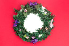Beautiful round Christmas garland on red background. Stock Image