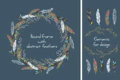 Beautiful round frame with feathers and    some floral elements. Royalty Free Stock Image
