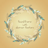 Beautiful round frame with feathers and    some floral elements. Stock Photo