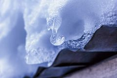 Beautiful round icicle on roof royalty free stock photography