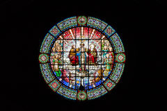 A beautiful round stained glass window in the monastery of Montserrat on a black background. Barcelona, Spain Stock Images
