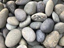 Beautiful round stones on the beach near the sea Stock Photo