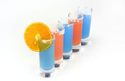 Beautiful row line of different colored alcohol cocktails Stock Photo
