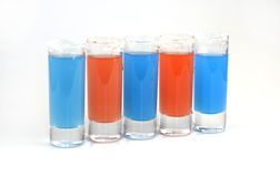 Beautiful row line of different colored alcohol cocktails Stock Photography